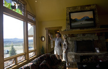 Kim Raff | The Salt Lake Tribune Bob and Sandy Hindy admire a stained glass window in the den of the 4,500-square-foot home on Dakota Trail in the Promontory in Park City Utah during the Park City Showcase of Homes on September 2, 2012.