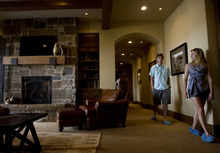 Kim Raff |  The Salt Lake Tribune Adam and Debbie O'Niell walk through the basement of the 5,022-square-foot home on Aspen Camp Loop in the Promontory in Park City Utah during the Park City Showcase of Homes  on September 2, 2012.