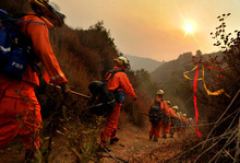 A female inmate fire crew hikes up to the fire line as they continue working on the Williams Fire that has scorched over 4,000 acres near Glendora, Calif., Monday, Sept. 3, 2012. (AP Photo/San Gabriel Valley Tribune, Keith Durflinger)