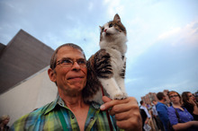 Leroy Bergstrom of Maple Plain, Minn. arrives with his cat Maestro before the Walker Art Center's first