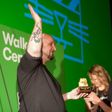 Will Branden of Seattle holds the Peoples Choice Award he won for