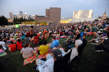 An estimated crowd of 6,000 gathered at sundown outside the Walker Art Center for the first