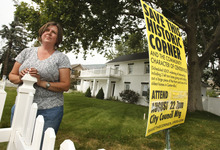 Leah Hogsten  |  The Salt Lake Tribune Karen Hainsworth Johnson stands in front of her family's historic house in Centerville. She and her family opposed Centerville city's plan to slice off a huge chunk of the front yard of the home, which has been in her family since 1864, to widen Main Street in an effort to lessen traffic congestion at Parrish Lane. On Tuesday, Sept. 4, 2012, the City Council voted to widen the street and take out about 10 feet of the front yards of several historic homes.