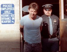 FILE - In this May 24, 1990 file photo, Robert Kosilek is led to the county jail following his arraignment on drunken driving charges, in New Rochelle, N.Y.  Kosilek was convicted in the 1990 murder of his wife in Massachusetts, and has been living as a woman, Michelle Kosilek, and receiving hormone treatments while serving life in prison in Massachusetts.  On Tuesday, Sept. 4, 2012, U.S. District Judge Mark Wolf ordered Massachusetts to provide a taxpayer-funded sex-change operation for Kosilek.  (AP Photo/Frankie Ziths, File)