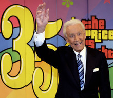 FILE - In this June 6, 2007 file photo shows game show host Bob Barker gesturing during the taping of his final episode of