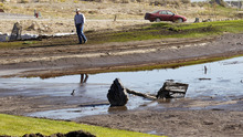 Al Hartmann     The Salt Lake Tribune A man walks around a clogged flood-retention basin in the Jacobs Ranch subdivision in Saratoga Springs on Tuesday, Sept. 4.