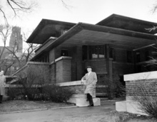 FILE - In this file photo of March 18, 1957, architect Frank Lloyd Wright visits Robie House, his 1909 Prairie style design, on Woodlawn Avenue in Chicago, Ill. A Frank Lloyd Wright archive of more than 23,000 architectural drawings and other material is being moved permanently to the Museum of Modern Art and Columbia University's Avery Architectural & Fine Arts Library in New York, it was announced, Tuesday, Sept. 4, 2012 by Sean Malone, president of the Frank Lloyd Wright Foundation. (AP Photo/File)