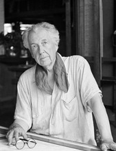 FILE -  In this file photo of Aug. 16, 1938, architect Frank Lloyd Wright is seen in his studio and home in Talisien, Spring Green, Wis. A Frank Lloyd Wright archive of more than 23,000 architectural drawings and other material is being moved permanently to the Museum of Modern Art and Columbia University's Avery Architectural & Fine Arts Library in New York, it was announced, Tuesday, Sept. 4, 2012 by Sean Malone, president of the Frank Lloyd Wright Foundation. (AP Photo/File)