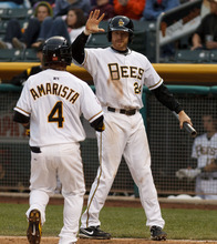 Trent Nelson  |  The Salt Lake Tribune Salt Lake's Doug Deeds (24) high-fives teammate Alexi Amarista after both scored on a Andrew Romine double in the fourth inning at Salt Lake Bees vs. Reno Aces baseball Friday, April 27, 2012 at Spring Mobile Ballpark in Salt Lake City.