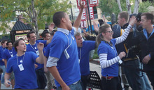 Rick Egan  | The Salt Lake Tribune   Apple Store employees high-five those that have been in line overnight, at the Apple store in the Gateway Center, for the new Apple iPhone 4S, Friday, October 14, 2011. There is even more anticipation building for the new iPhone 5, which is expected to be announced Sept. 12. But there may be reasons to hold off on buying the new phone.
