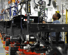 (AP Photo/Rainier Ehrhardt) Nationally, factory activity shrank for the third straight month in August as new orders, production and employment all fell.