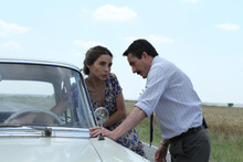 Kenan (Serkan Ercan, right), a toll taker on a lonely road, meets a beautiful woman (Nur Eysan) at his remote outpost in the Turkish film