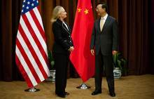 U.S. Secretary of State Hillary Rodham Clinton, left, talks with Chinese Foreign Minister Yang Jiechi, at the Ministry of Foreign Affairs in Beijing Tuesday, Sept. 4, 2012.  Clinton is in Beijing to press Chinese authorities to agree to peacefully resolve disputes with their smaller neighbors over competing territorial claims in the South China Sea. (AP Photo/Jim Watson, Pool)