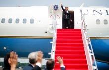U.S. Secretary of State Hillary Rodham Clinton, center, waves as she departs Halim Perdanakusuma International Airport in Jakarta, Indonesia, Tuesday, Sept. 4, 2012. (AP Photo/Jim Watson, Pool)