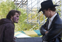 Chris (Emile Hirsch, left) tries to renegotiate a deal with a cop-turned-contract killer, Joe Cooper (Matthew McConaughey), in the drama