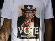 In this photo taken Monday Sept. 3, 2012, a worker at Cafe Cremers coffee shop in The Hague, Netherlands, who does not want to be identified, wears a T-shirt urging people to vote against the country's