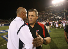 Scott Sommerdorf  |  The Salt Lake Tribune  Utah State head coach Brent Guy (L), speaks to Utah Head coach Kyle Whittingham after the blowout loss Saturday, 9/13/08. The Utes defeated Utah State 58-10.