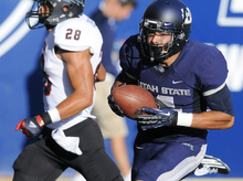 Utah State wide receiver Matt Austin catches a 35 yard touchdown as Southern Utah defensive back Miles Killebrew (28) defends during their NCAA college football game, Thursday, Aug. 30, 2012, in Logan, Utah. (AP Photo/The Herald Journal, Eli Lucero)