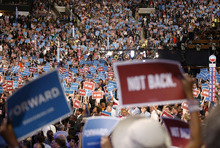 Delegates wave the signs during the Democratic National Convention in Charlotte, N.C., on Tuesday, Sept. 4, 2012. (AP Photo/Jae C. Hong)