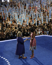 First Lady Michelle Obama, right, is greeted by Elaine Brye at the Democratic National Convention in Charlotte, N.C., on Tuesday, Sept. 4, 2012. (AP Photo/Charlie Neibergall)