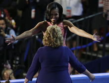 First Lady Michelle Obama hugs Elaine Brye before speaking at the Democratic National Convention in Charlotte, N.C., on Tuesday, Sept. 4, 2012. (AP Photo/Lynne Sladky)
