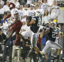 Chris Detrick  |  The Salt Lake Tribune Brigham Young Cougars tight end Kaneakua Friel (82) makes a touchdown catch past Washington State Cougars cornerback Daniel Simmons (24) during the first half of the game against Washington State at LaVell Edwards Stadium in Provo on Thursday, Aug. 30, 2012.