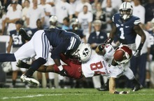 Kim Raff | The Salt Lake Tribune Brigham Young Cougars defensive back Jordan Johnson (6) hits Washington State Cougars wide receiver Gabe Marks (84) while he attempts a catch during BYU's home opener at LaVell Edwards Stadium in Provo on Aug. 30, 2012.