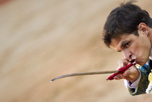File - In this July 14, 2011 file photo, Spanish bullfighter Julian Lopez 'El Juli' aims his sword to kill a bull during a bullfight in Pamplona, Spain. Bullfights return live to Spanish state TV Wednesday Sept. 5, 2012, six years after the fights were banned from the widely watched public channel with the broadcast featuring one of Spain's most  storied bullfighters and giving a boost to a tradition hit hard by declining popularity and a dire economic crisis. Julian Lopez, known by his nickname