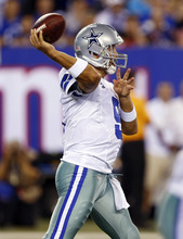 Dallas Cowboys quarterback Tony Romo throws against the New York Giants during the first half of an NFL football game Wednesday, Sept. 5, 2012, in East Rutherford, N.J. (AP Photo/Julio Cortez)