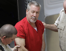 FILE - In this May 8, 2009 file photo, former Bolingbrook, Ill., police sergeant Drew Peterson arrives at the Will County Courthouse in Joliet, Ill., for his arraignment on charges of first-degree murder in the 2004 death of his former wife Kathleen Savio, who was found in an empty bathtub at home. Attorneys will deliver closing arguments at Drew Peterson's trial Tuesday, after which jurors will begin deliberations on whether the state proved the former Illinois police officer murdered his third wife. The sides make their final pitches after five weeks of testimony about the 2004 death of Kathleen Savio, whose body was found in a dry bathtub of her suburban home outside Chicago with a gash on the back of her head. (AP Photo/M. Spencer Green, File)