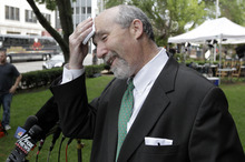 Attorney for Former Bolingbrook police officer Drew Peterson, Joel Brodsky wipes his brow before entering court for jury instructions, Wednesday, Sept. 5, 2012, in Joliet, Ill. Jurors are expected to begin deliberating on allegations the former suburban Chicago police officer murdered his third wife. (AP Photo/M. Spencer Green)