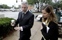 Will County States Attorney James Glasgow enters court for jury instructions in the murder trial of former Bolingbrook police officer Drew Peterson, Wednesday, Sept. 5, 2012, in Joliet, Ill. Jurors are expected to begin deliberating on allegations the former suburban Chicago police officer murdered his third wife. (AP Photo/M. Spencer Green)