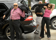 Attorneys for Former Bolingbrook police officer Drew Peterson, Joe, and Lisa Lopez prepare to enter court for jury instructions, Wednesday, Sept. 5, 2012, in Joliet, Ill. Jurors are expected to begin deliberating on allegations the former suburban Chicago police officer murdered his third wife later today. (AP Photo/Paul Beaty)