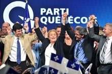 Parti Quebecois Leader Pauline Marois returns to complete her speech after being whisked off the stage by security as she delivered her victory speech in Montreal, Que., Tuesday, Sept. 4, 2012. With the win, Marois becomes the first female premier in Quebec history. (AP Photo/Paul Chiasson, The Canadian Press)