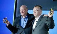 Steve Ballmer, left, Chairman and CEO of Microsoft, and Stephen Elop, CEO of Nokia, introducee Nokia's newest smartphone, the Lumia 920, equipped with Microsoft's Windows Phone 8, Wednesday, Sept. 5, 2012 in New York. Nokia revealed its first smartphones to run the next version of Windows, a big step for a company that has bet its future on an alliance with Microsoft. (AP Photo/Mark Lennihan)