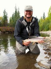 Brett Prettyman and his Arctic grayling on Monument Creek near Chena Hot Springs in Alaska.