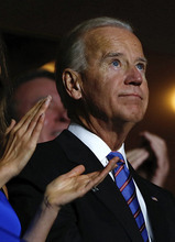 Vice President Joe Biden looks up at the television monitor as he is nominated for a second term as Vice President during the Democratic National Convention in Charlotte, N.C., on Thursday, Sept. 6, 2012. (AP Photo/Carolyn Kaster)