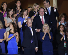 Vice President Joe Biden waves from the VIP gallery after being nominated fora second term as Vice President at the Democratic National Convention in Charlotte, N.C., on Thursday, Sept. 6, 2012. (AP Photo/J. Scott Applewhite)