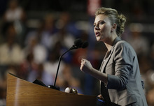 Actress Scarlett Johansson addresses the Democratic National Convention in Charlotte, N.C., on Thursday, Sept. 6, 2012. (AP Photo/David Goldman)