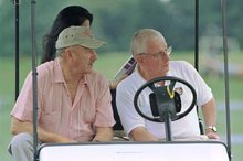 FILE - Actor Gene Hackman, left, watches the Baltimore Ravens' morning workout along with Ravens owner Art Modell on in this July 30, 1999 file photo taken at Westminster College in Westminster, Md. The Baltimore Ravens  said Modell died early Thursday Sept. 6, 2012 at Johns Hopkins Hospital, where he had been admitted Wednesday. A cause of death was not given.   (AP Photo/Dave Hammond, File)