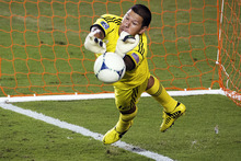 Real Salt Lake goalkeeper Nick Rimando makes a save on a penalty kick by Houston Dynamo midfielder Brad Davis during an MLS soccer match, Thursday, Sept. 6, 2012, in Houston. Houston won 1-0. (AP Photo/Houston Chronicle, Smiley N. Pool)  MANDATORY CREDIT