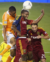 Real Salt Lake midfielder Yordany Alvarez wins a header against Houston Dynamo defender Ricardo Clark during an MLS soccer match, Thursday, Sept. 6, 2012, in Houston. Houston won 1-0. (AP Photo/Houston Chronicle, Smiley N. Pool)  MANDATORY CREDIT