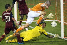 Real Salt Lake goalkeeper Nick Rimando makes a save against Houston Dynamo forward Will Bruin during an MLS soccer match, Thursday, Sept. 6, 2012, in Houston. (AP Photo/Houston Chronicle, Smiley N. Pool)  MANDATORY CREDIT