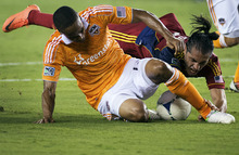 Houston Dynamo defender Ricardo Clark, left, makes a stop on Real Salt Lake forward Fabian Espindola during an MLS soccer match, Thursday, Sept. 6, 2012, in Houston. (AP Photo/Houston Chronicle, Smiley N. Pool)  MANDATORY CREDIT