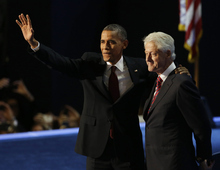 President Barack Obama waves with former President Bill Clinton after Clinton's speech to the Democratic National Convention in Charlotte, N.C., on Wednesday, Sept. 5, 2012.(AP Photo/Lynne Sladky)