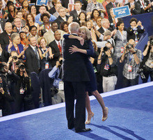 Vice President Joe Biden, left, is hugged by his wife Jill Biden, right, on stage at the Democratic National Convention in Charlotte, N.C., Thursday, Sept. 6, 2012. (AP Photo/Pablo Martinez Monsivais)