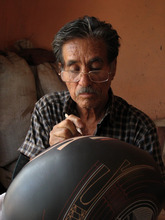 Courtesy photo Artist Nicolas Quezada paints a large pot in a scene from the documentary