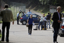 Journalists wait in front of Gendarmes, who block access to the site of a killing near Chevaline, French Alps, Thursday Sept. 6, 2012.  French authorities say at least four people have been shot to death in a British-registered car in a forest in the Alps. A French prosecutor says a 4-year-old girl has been found alive in the car among three corpses after hiding under them for eight hours. (AP Photo/Laurent Cipriani)