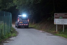 A Gendarme's car heads to a killing site near Chevaline, French Alps, Wednesday Sept.5, 2012.  French authorities say at least four people have been shot to death in a forest in the Alps. An official with the regional administration for the Haute-Savoie region says three of the bodies were found in a BMW registered in Britain. (AP Photo/Alexis Moro)