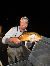 Flaming Gorge Resort co-owner and fishing guide, Kevin Clegg, with a whopper brown trout.  Courtesy photo